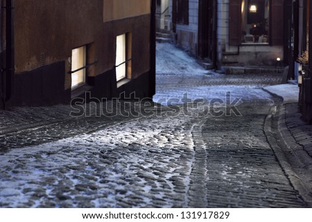 Narrow street with cobble stones in the old town of Stockholm, Sweden - stock photo