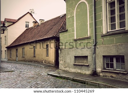 Narrow street with cobblestones in the old town of Tallinn, Estonia - stock photo