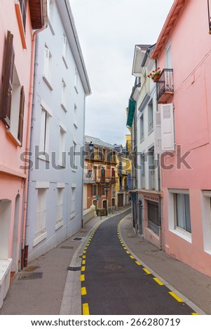 Narrow street with houses in Lourdes France - stock photo