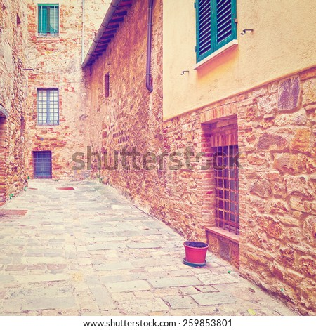 Narrow Street with Old Buildings in Italian City of Cetona, Instagram Effect - stock photo