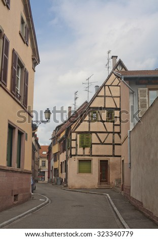 Narrow street with old buildings in Selestat, Alsace, France - stock photo