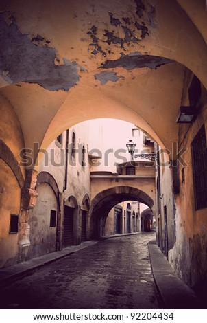 Narrow street with vault in Florence, Italy - stock photo