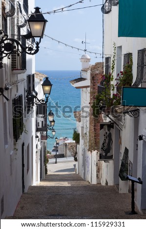 Narrow streets a stairs in the old part of Spanish City, Almea Costa Blanca, Spain, Europe - stock photo