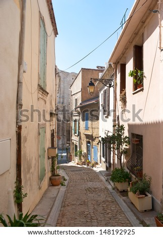Narrow streets have their own charme and could bring you to the main landmark of the city, Arles, France.
