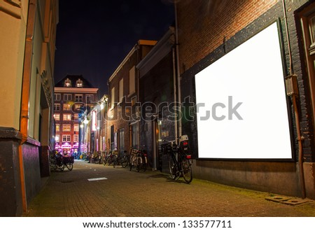 narrow streets of Amsterdam at night - stock photo