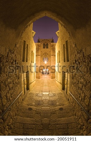 narrow streets of Jerusalem's Old City at night.