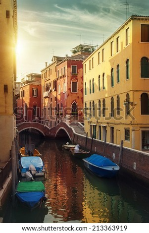Narrow water canal in Venice, Italy - stock photo