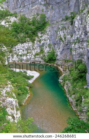 Narrow water stream flowing at the bottom of a canyon - stock photo