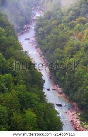 Narrow water stream flowing at the bottom of Tara canyon - stock photo