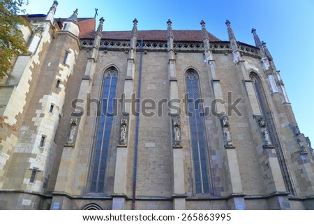 Narrow windows in the side of Gothic building of the Black Church, Brasov, Romania - stock photo