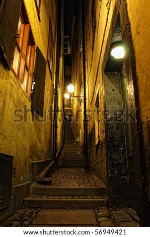 Narrowest street at night in the old town (Gamla Stan) of Stockholm, Sweden - stock photo