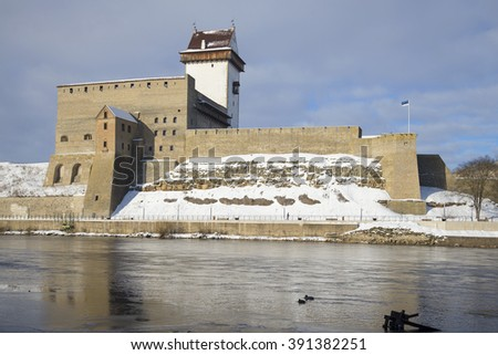 NARVA, ESTONIA - MARCH 02, 2016: Castle view Herman cloudy March afternoon