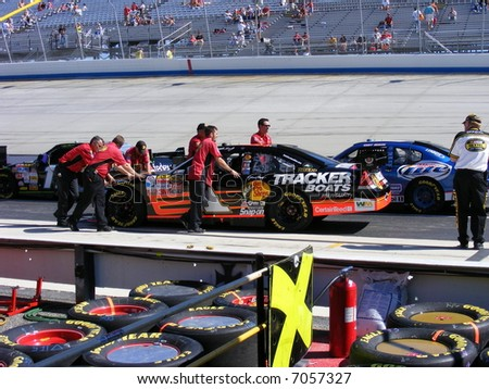 nascar`s jeffery earnhardt`s car getting pushed onto the track