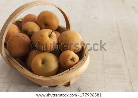 Nashi pears in vintage trug - stock photo