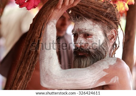 NASHIK - SEP 12:An unidentified Naga Sadhu gets ready to participate in the religious event Kumbh Mela on September 12, 2015 in Nashik, India.Kumbhmela is a Hindu religious event gathered by millions. - stock photo