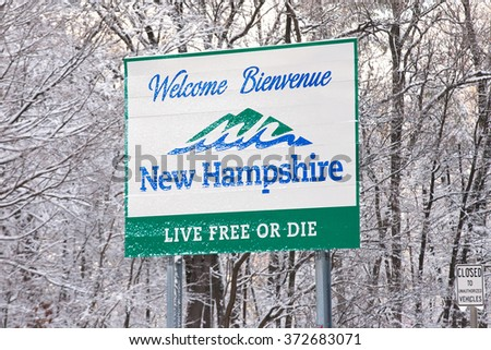 NASHUA, NH  FEBRUARY 5: New Hampshire welcome sign and trees are covered with fresh fallen snow on February 5, 2016 in Nashua, NH. A Donald Trump campaign event was canceled due to the snow storm.