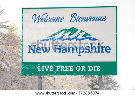 NASHUA, NH  FEBRUARY 5: Welcome sign for New Hampshire is covered with fresh fallen snow on February 5, 2016 in Nashua, NH. A Donald Trump campaign event was canceled due to the snow storm.
