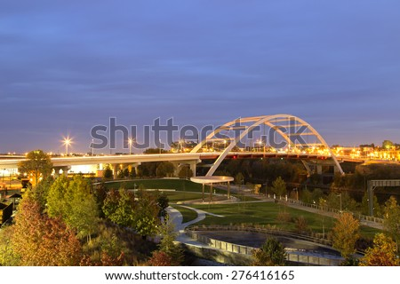 Nashville city  Bridge over park at sunset with traffic lights - stock photo