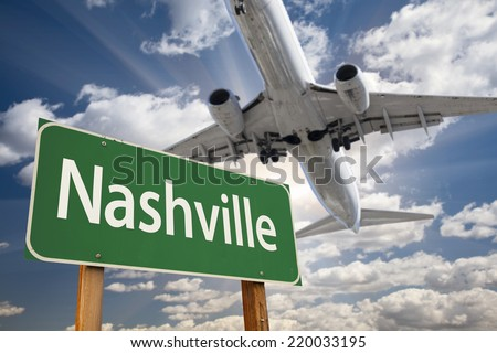 Nashville Green Road Sign and Airplane Above with Dramatic Blue Sky and Clouds. - stock photo