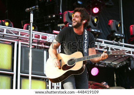 NASHVILLE-JUL 11: Country recording artist Thomas Rhett performs during Luke Bryan's 'Kick The Dust Up' Tour at Vanderbilt Stadium on July 11, 2015 in Nashville, Tennessee. - stock photo