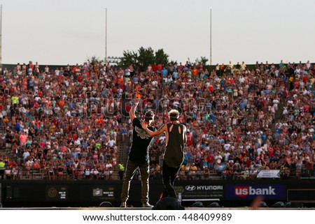 NASHVILLE-JUL 11: Singers Tyler Hubbard (L) and Brian Kelley of Florida Georgia Line perform during the 'Kick The Dust Up' Tour at Vanderbilt Stadium on July 11, 2015 in Nashville, Tennessee. - stock photo