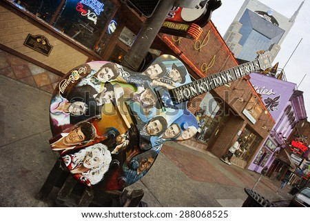 NASHVILLE, TENNESSEE-FEBRUARY 4, 2015:  Broadway Street in Nashville, Tennessee is the hub of the Honky Tonk district. - stock photo
