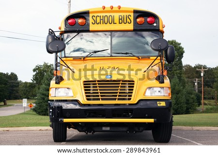 NASHVILLE, TENNESSEE-JUNE, 2015:  Close up of the front of a new school bus - stock photo