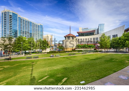 NASHVILLE, TENNESSEE - JUNE 14, 2013: Country Music Hall of Fame viewed from Music City Walk of Fame Park.  - stock photo