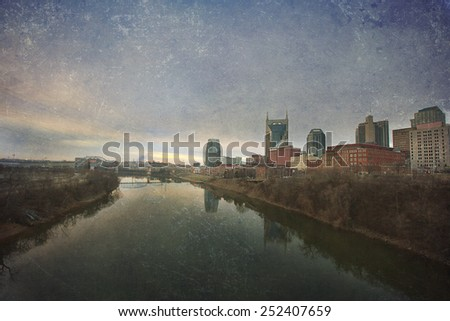 Nashville, Tennessee skyline at sunrise.  This image has an artistic texture overlay for a fine art, vintage feel. - stock photo