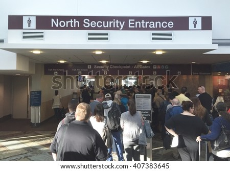 NASHVILLE, TN-APRIL 18, 2016:  People wait in the security line at Nashville International airport. The number of TSA agents is not sufficient for the passengers waiting for their security clearance. - stock photo