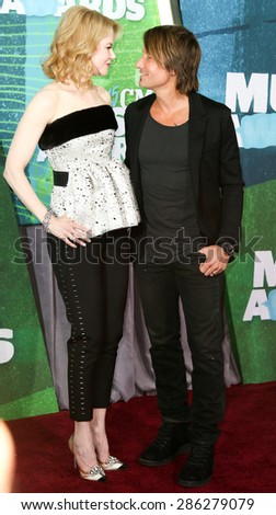 NASHVILLE, TN-JUN 10: Actress Nicole Kidman and singer Keith Urban attend the 2015 CMT Music Awards at the Bridgestone Arena on June 10, 2015 in Nashville, Tennessee. - stock photo