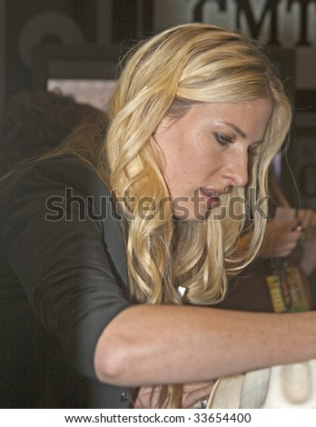 NASHVILLE, TN - JUNE 13: Country singer Holly Williams signs autographs in the Nashville Convention Center during the CMA Festival June 13, 2009 in Nashville, Tennessee.