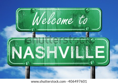 nashville vintage green road sign with blue sky background - stock photo