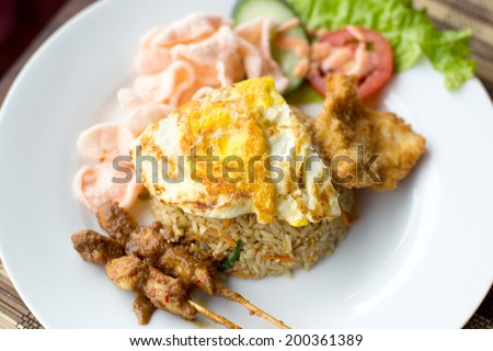 Nasi Goreng with prawn crackers and chicken satay - Indonesian dish