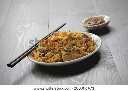 Nasi goreng with sambal - fried rice with chili paste - stock photo