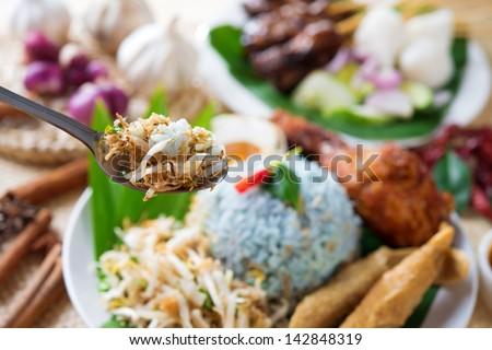 Nasi kerabu, famous Malaysian Malay rice dish. Traditional east coast blue rice. Popular in states such as Terengganu or Kelantan . Malaysia food, Asian cuisine. - stock photo