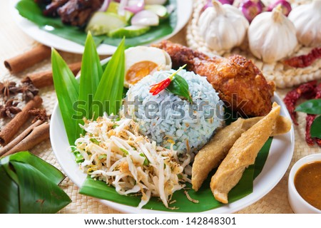 Nasi kerabu or nasi ulam, popular Malaysian Malay rice dish. Blue color of rice resulting from the petals of butterfly-pea flowers. Traditional Malaysia food, Asian cuisine. - stock photo