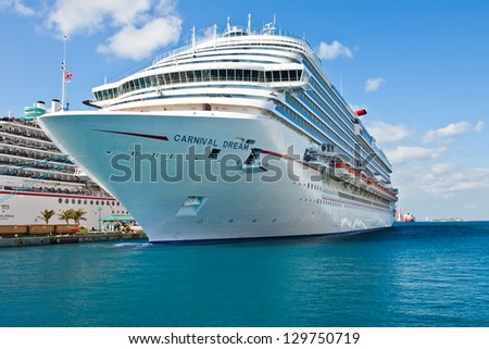 NASSAU, BAHAMAS - JAN. 13:  Carnival Dream docked in the port of the Bahamas on Jan. 13, 2013. At 130,000 tons, the ship is the largest to date for Carnival Cruise Lines. - stock photo