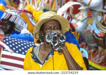 NASSAU, THE BAHAMAS - JANUARY 1: Musician in traditional costume at Junkanoo Festival on January 1st 2014 in Nassau, the Bahamas - stock photo