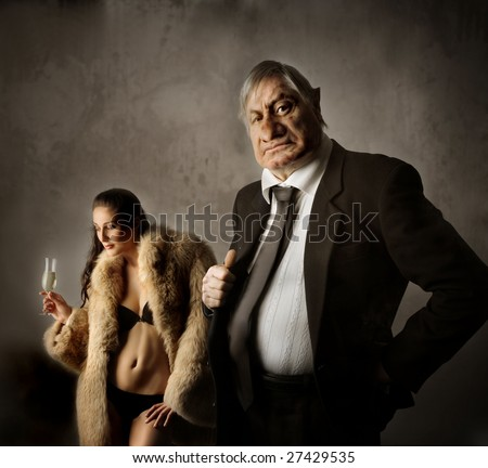 nasty businessman and his sexy mistress - stock photo