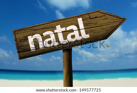 Natal, Brazil wooden sign with a beach on background   - stock photo