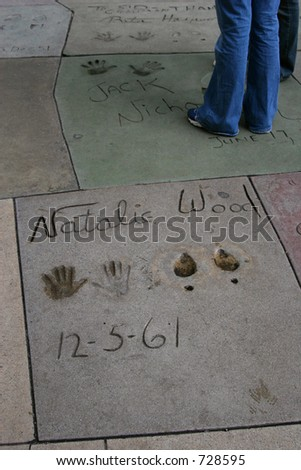 Natalie Wood's hand and footprints from 1961 at Grauman's Chinese Theater on Hollywood Boulevard in Hollywood, California. - stock photo