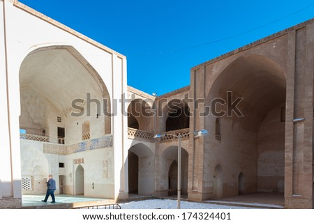 NATANZ, IRAN - JANUARY 9, 2014:  Interior part of the Jameh Mosque in Natanz, Iran, Jan 9, 2014. This mosque was built around the Tomb of Abd al Samad built in 1304.