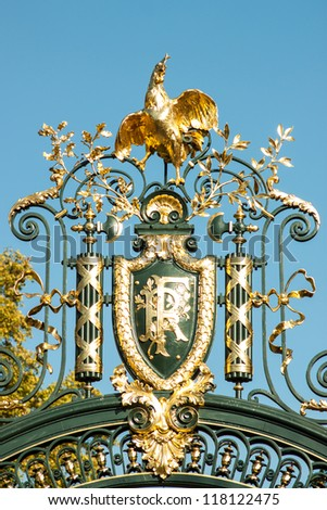 Nation emblem of the Republic of France on a decorated metal door - stock photo