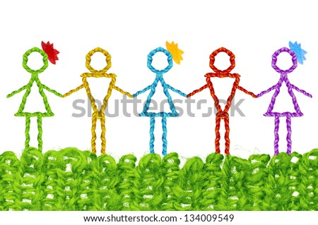 Nation friendship concept, infant simplicity design from woolen knit of people symbolizing the friendship of different races. - stock photo