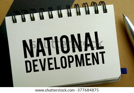 National development memo written on a notebook with pen