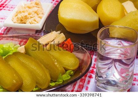 national dish: salty cucumburs  with boiled potatoes