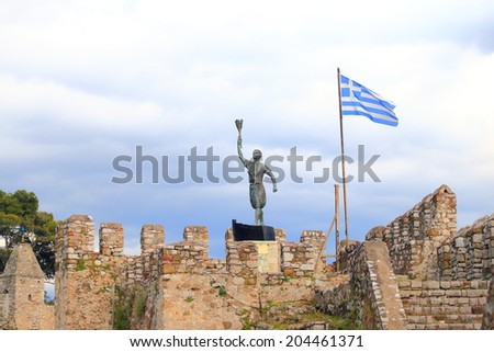 National flag of Greece on a mast above the Venetian walls of Nefpaktos, Greece  - stock photo