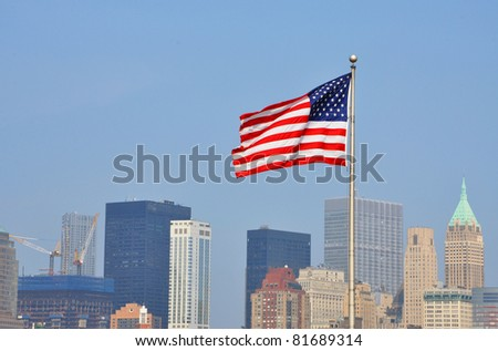 National Flag of United States, with Manhattan skyline in the background, Liberty State Park, New Jersey, USA - stock photo