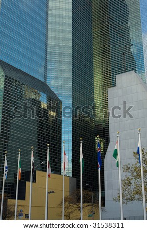 National flags and UN Headquarters building in New York - stock photo